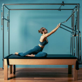woman working out using pilates machine