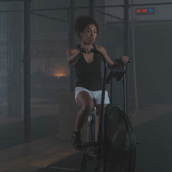 black female working out with a gym bike