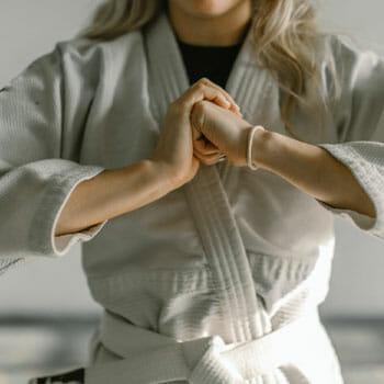 woman in a white martial arts uniform