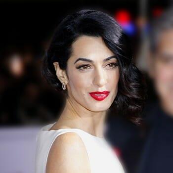 Amal wearing a white dress