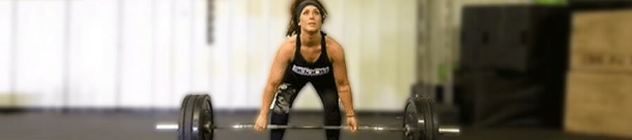 Chelsea about to lift a barbell