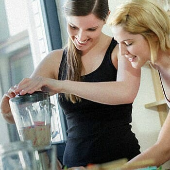 Two girls making a protein shake