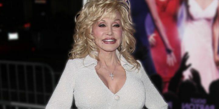 Dolly Parton smiling, wearing a white dress