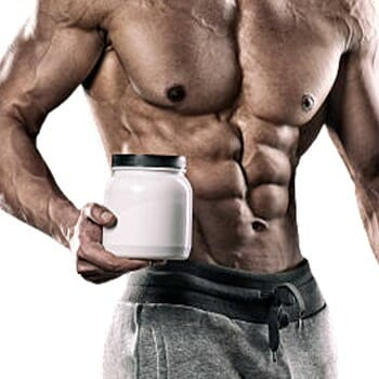 A guy holding a creatine supplement container
