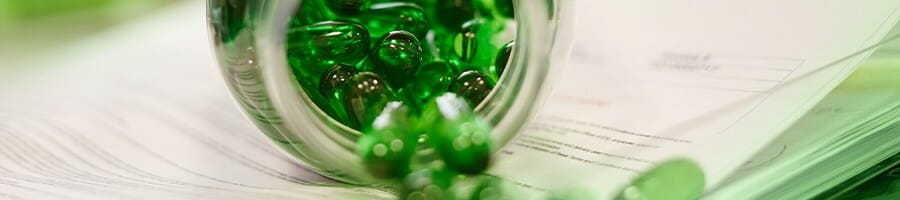 Green supplements coming out from a bottle