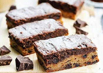 Chocolate peanut butter bars with chocolate on its side