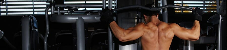 Guy performing wide grip lat pulldown alone