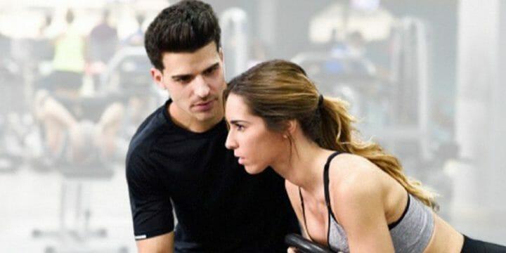 A man coaching a woman