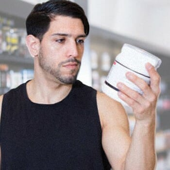 A guy looking at creatine's nutrition facts