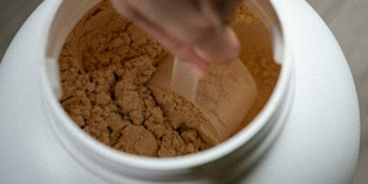 A big scoop of creatine from a container