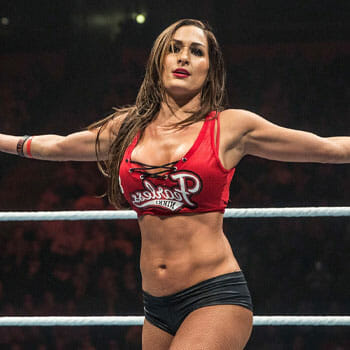 Nikki Bella in a two piece costume inside the WWE wresting ring