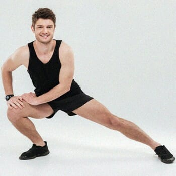 A guy stretching his lower body