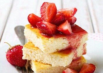 Pineapple cheesecake bars with strawberries as a toppings