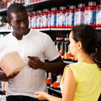 Athletes having a conversation inside a workout supplement store