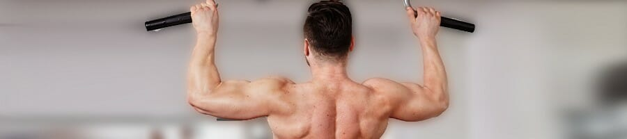 Man doing a wide grip lat pullup