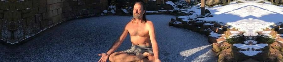 Wim Hof meditating in a yard