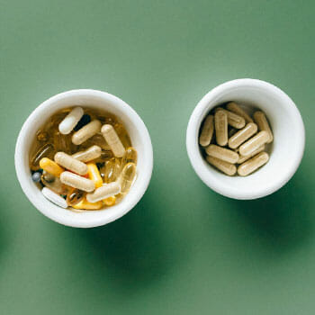 two bowls of different pills
