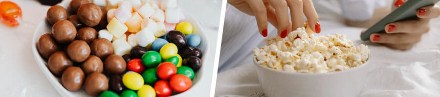 bowl filled with candies, close up image of a woman grabbing popcorn from a bowl
