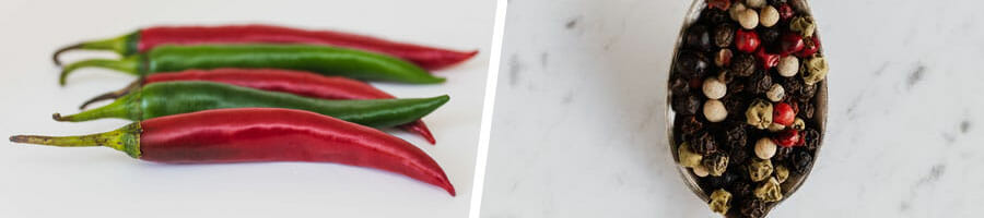 close up image of fresh cayenne pepper, and a spoonful of black pepper