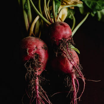 three beetroots in a black background