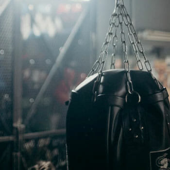 black hanging heavy bag in a gym
