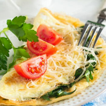 plate of omelet and vegetables