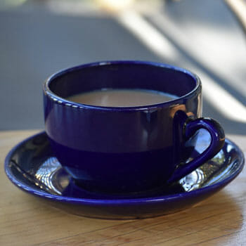blue mug filled with hot coffee