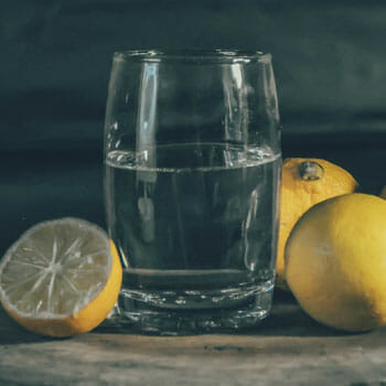 fresh lemon and a glass filled with water