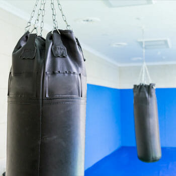 gym with hanging punching bags