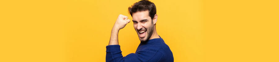 man smiling with his one arm flexing