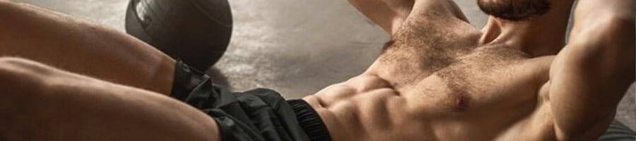 man doing an ab workout inside a gym