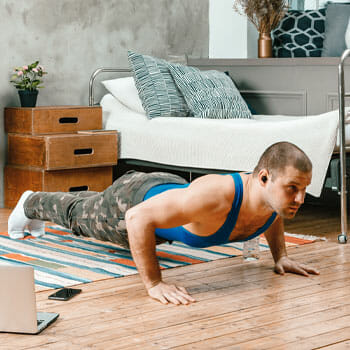 man in a push up position at home