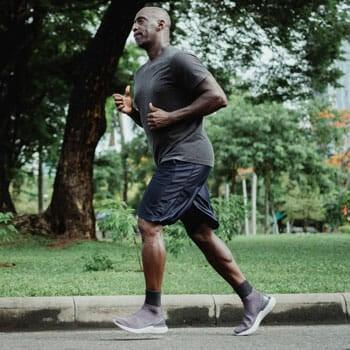 black man jogging outdoors