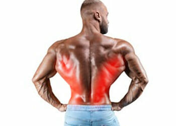 shirtless man showing his back with his lats highlighted