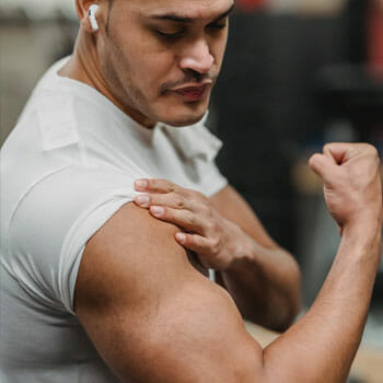 man flexing his bicep muscles