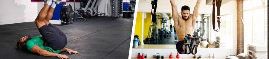 man doing reverse crunches in a gym, man doing hanging leg raises