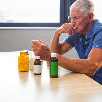 man looking through his supplements