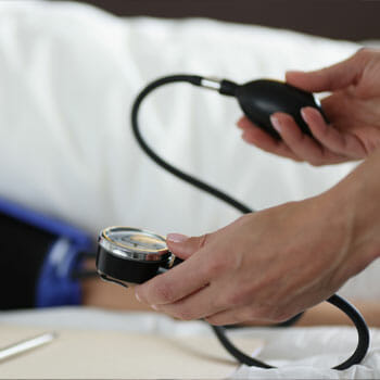 man checking his blood pressure