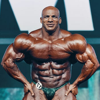 big ramy posing with his muscle out on stage