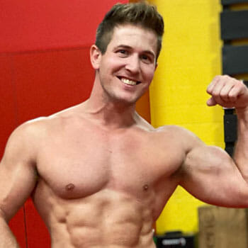 shirtless Scott Herman flexing his biceps