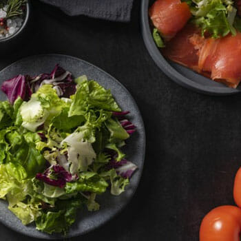 plate filled with green salad leaves