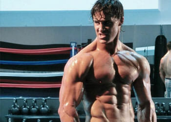 portrait image of greg plitt in a gym