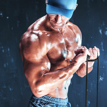 man showing off his sweaty body muscles