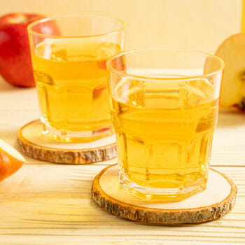 two shots filled with apple cider vinegar