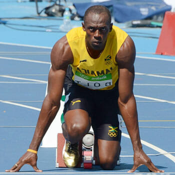 usain bolt about to sprint in a track and field
