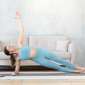 woman in a side plank position at home