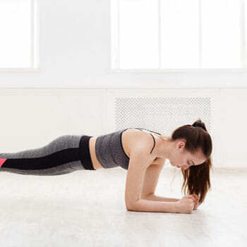 woman in a plank position at home