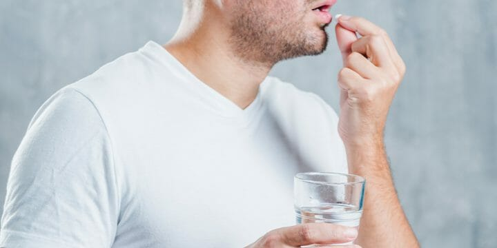A man taking a vitamin