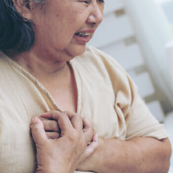 A woman having a severe chest pain