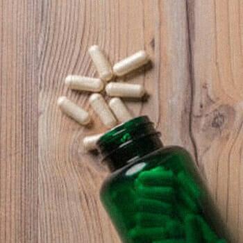 Vitamins spilled on a wooden platform